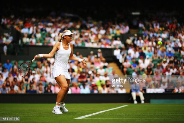 Sabine Lisicki of Germany plays a forehand during her Ladies' Singles first round match against against Julia Glushko of Israel on day two of the...