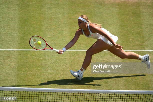 Sabine Lisicki of Germany plays a forehand during the Ladies' Singles final match against Marion Bartoli of France on day twelve of the Wimbledon...