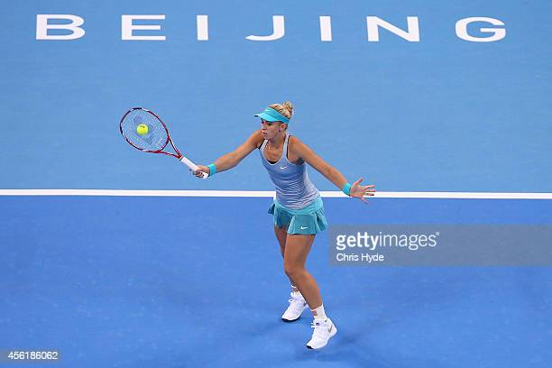 Sabine Lisicki of Germany plays a forehand in her match against Shilin Xu of China during day one of the China Open at the China National Tennis...