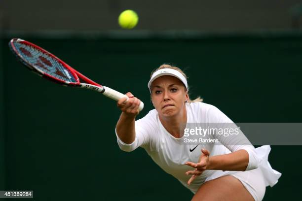 Sabine Lisicki of Germany plays a forehand return during her Ladies' Singles third round match against Ana Ivanovic of Serbia on day six of the...