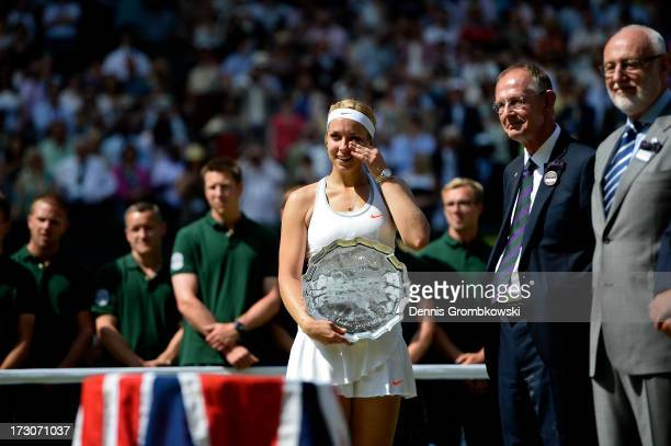 Sabine Lisicki of Germany reacts after receiving her runner-up trophy from Prince Edward, Duke of Kent on Centre Court after her Ladies' Singles...