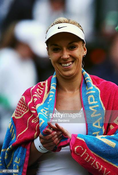 Sabine Lisicki of Germany reacts as she walks of after play was suspended during her Ladies' Singles third round match against Ana Ivanovic of Serbia...