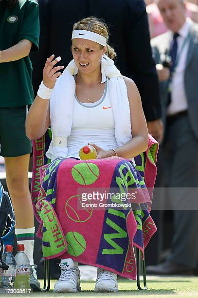 Sabine Lisicki of Germany reacts during a break in the Ladies' Singles final match against Marion Bartoli of France on day twelve of the Wimbledon...
