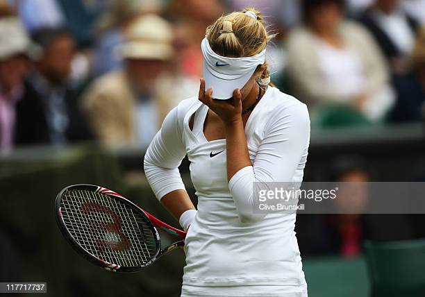 Sabine Lisicki of Germany reacts to a play during her semifinal round match against Maria Sharapova of Russia on Day Ten of the Wimbledon Lawn Tennis...