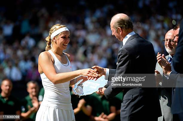 Sabine Lisicki of Germany receives her runnerup trophy from Prince Edward Duke of Kent on Centre Court after her Ladies' Singles final match against...