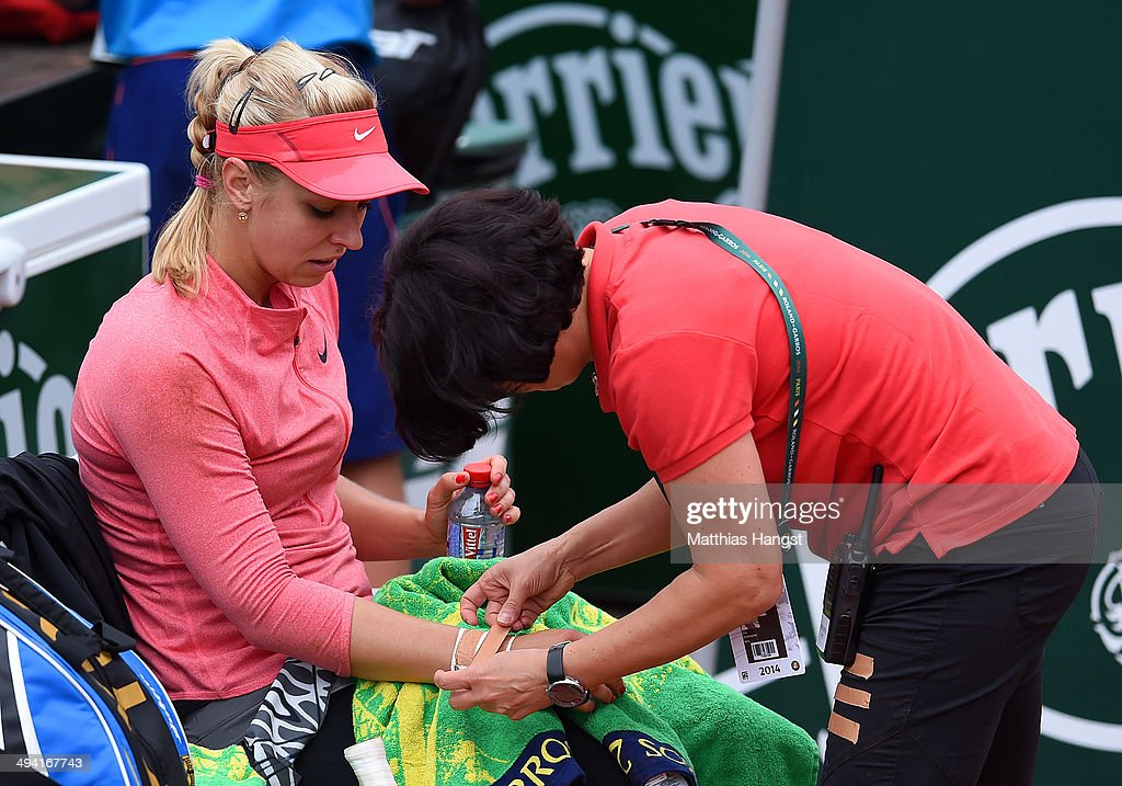 Sabine Lisicki of Germany receives treatment for an injury during her women's singles match against Mona Barthel of Germany on day four of the French Open at Roland Garros on May 28, 2014 in Paris, France.