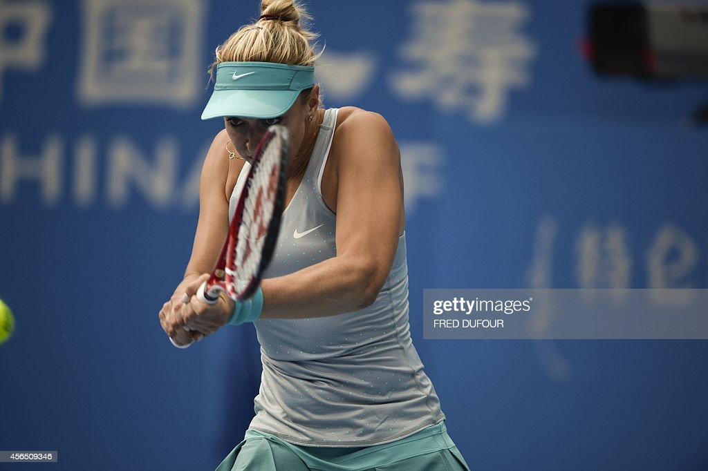 Sabine Lisicki of Germany returns a shot against Ana Ivanovic of Serbia during their women's singles third round match at the China Open tennis tournament in the National Tennis Center of Beijing on October 2, 2014.