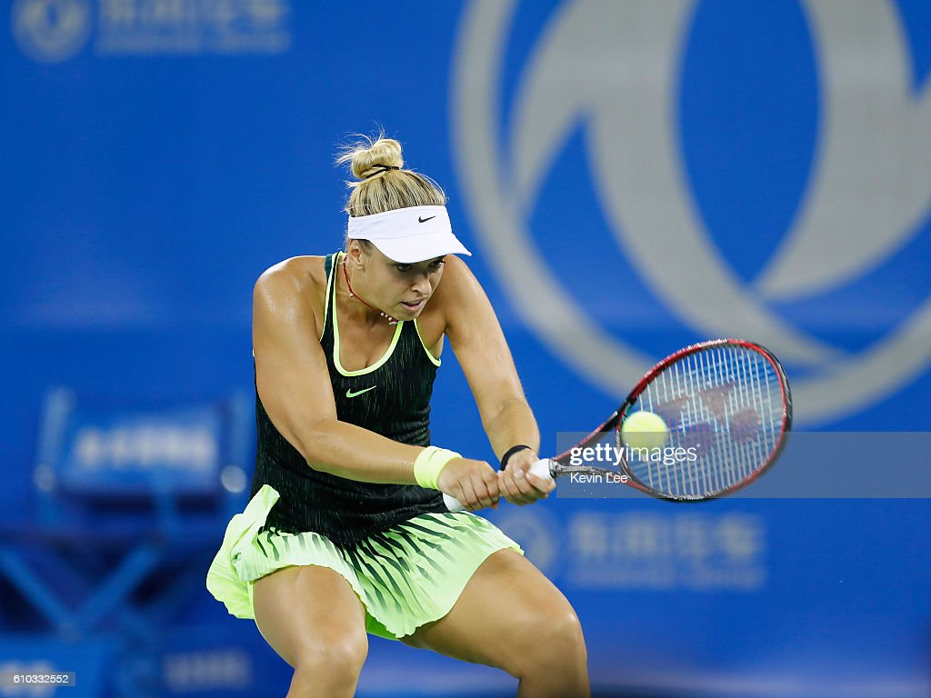 Sabine Lisicki of Germany returns a shot against Ekaterina Makarova of Russia in a match against during Day 1 of the 2016 Wuhan Open at Optics Valley International Tennis Center on September 25, 2016 in Wuhan, China.