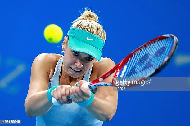 Sabine Lisicki of Germany returns a shot against Shilin Xu of China during day one of the China Open at the China National Tennis Center on September...