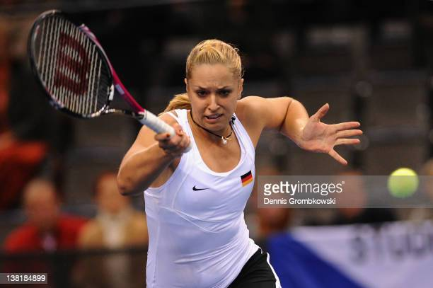 Sabine Lisicki of Germany returns the ball at her single match against Iveta Benesova of Czech Republic during day one of the Federation Cup 2012...
