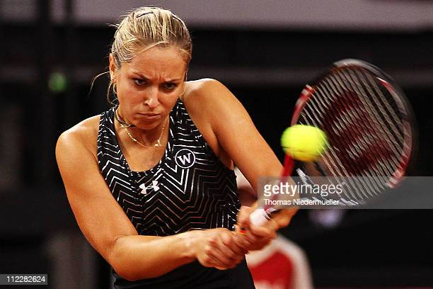 Sabine Lisicki of Germany returns the ball to Christina McHale of USA during the second day of the Fed Cup match between Germany and United States at...
