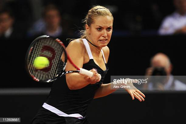 Sabine Lisicki of Germany returns the ball to Dominika Cibulkova of Slovakia during their first round match at the Porsche Tennis Grand Prix at...