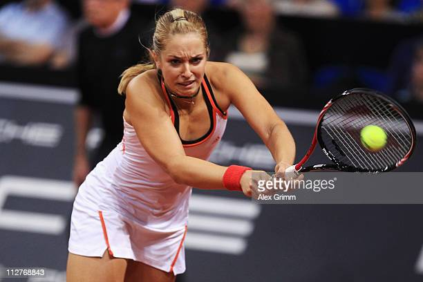 Sabine Lisicki of Germany returns the ball to Julia Goerges of Germany during their Quarter Final match at the Porsche Tennis Grand Prix at Porsche...