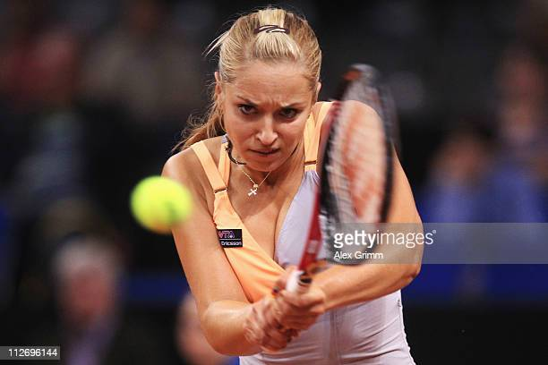 Sabine Lisicki of Germany returns the ball to Na Li of China during their second round match at the Porsche Tennis Grand Prix at Porsche Arena on...
