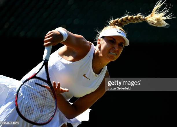 Sabine Lisicki of Germany serves against Anna Kalinskaya of Russia during Wimbledon Championships Qualifying Day 2 at The Bank of England Sports...