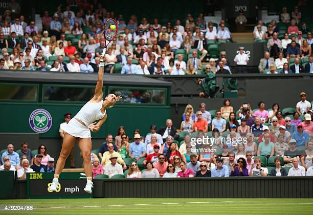 Sabine Lisicki of Germany serves against Christina McHale of USA in her Women's Singles Second Round match during day four of the Wimbledon Lawn...