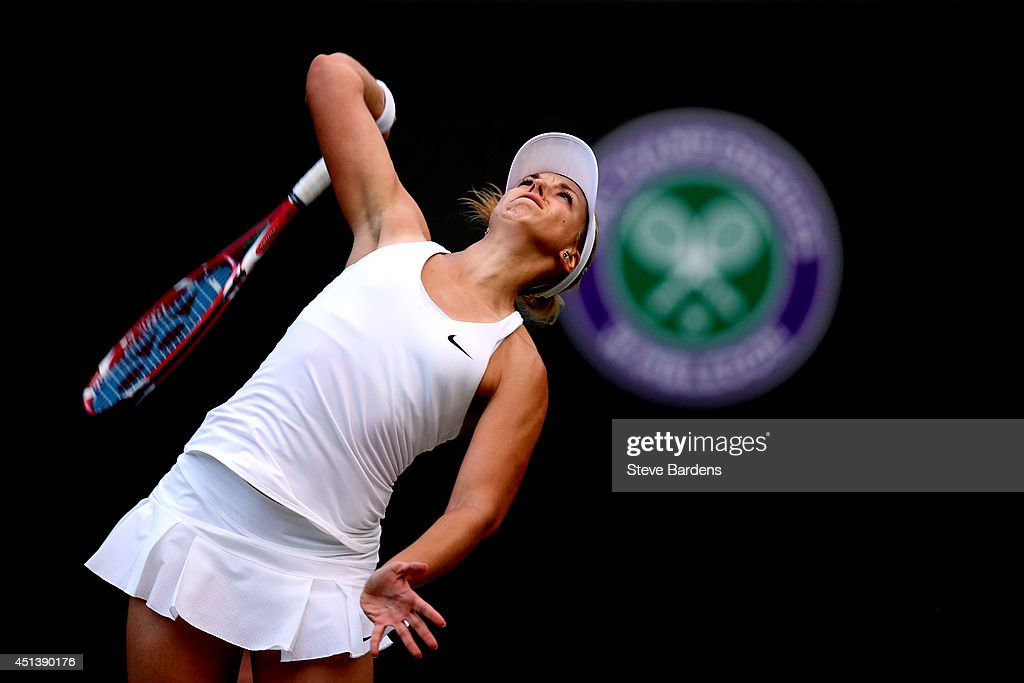 Sabine Lisicki of Germany serves during her Ladies' Singles third round match against Ana Ivanovic of Serbia on day six of the Wimbledon Lawn Tennis Championships at the All England Lawn Tennis and Croquet Club at Wimbledon on June 28, 2014 in London, England.