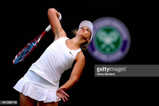 Sabine Lisicki of Germany serves during her Ladies' Singles third round match against Ana Ivanovic of Serbia on day six of the Wimbledon Lawn Tennis...