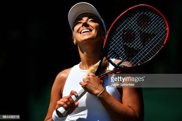 Sabine Lisicki of Germany serves reacts Anna Kalinskaya of Russia during Wimbledon Championships Qualifying Day 2 at The Bank of England Sports...