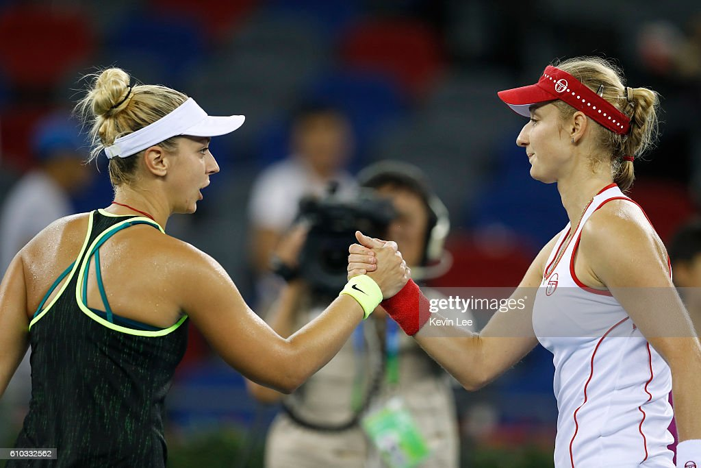 Sabine Lisicki of Germany(L) shakes after she lost the match against Ekaterina Makarova of Russia during Day 1 of the 2016 Wuhan Open at Optics Valley International Tennis Center on September 25, 2016 in Wuhan, China.