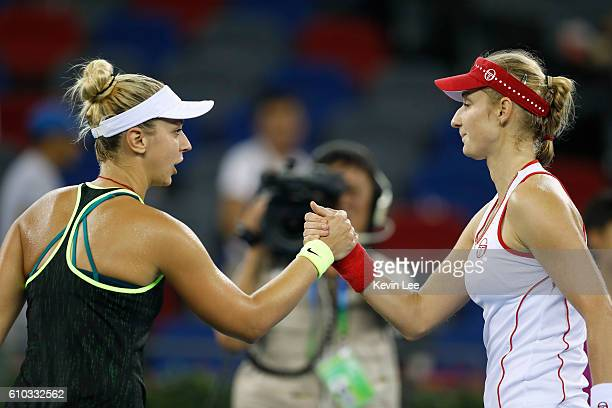 Sabine Lisicki of Germany shakes after she lost the match against Ekaterina Makarova of Russia during Day 1 of the 2016 Wuhan Open at Optics Valley...