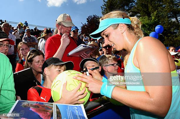 Sabine Lisicki of Germany signs autographs after her match against Silvia SolerEspinosa of Spain during Day Three of the Nuernberger Versicherungscup...
