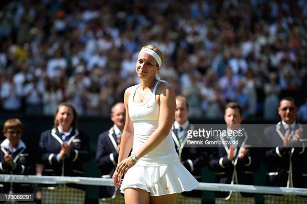 Sabine Lisicki of Germany walks across the court to receive her runnerup trophy from Prince Edward Duke of Kent on Centre Court after her Ladies'...