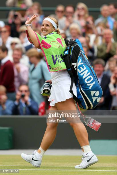 Sabine Lisicki of Germany waves to the crowd as she leaves court following her victory in the Ladies' Singles quarterfinal match against Kaia Kanepi...