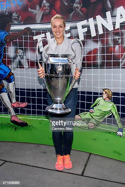 Sabine Lisicki poses with the cup during the UEFA Champions League Trophy Tour Berlin on April 29 2015 in Berlin Germany