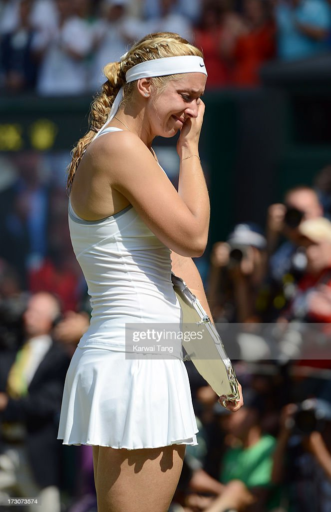Sabine Lisicki with the runner-up trophy after being beaten by Marion Bartoli in the Ladies Singles Final on Day 12 of the Wimbledon Lawn Tennis Championships at the All England Lawn Tennis and Croquet Club on July 6, 2013 in London, England.