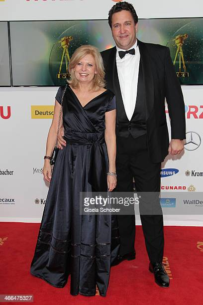 Sabine Postel and boyfriend Christian Meckel attend the Goldene Kamera 2014 at Tempelhof Airport Hangar 7 on February 1 2014 in Berlin Germany Photo...