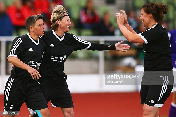 Sabine Stuermer of SG Dirmingen celebrate the decisive goal with team mates Barbara Holz and Verena Otto during the DFB Women's Over35 Cup final...