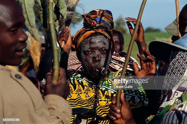 A Sabiny boy blow a whistle and dances through his village during his circumcision ceremony in Kapchorwa Uganda Male circumcision is a traditional...