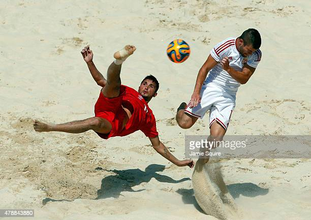 Sabir Allahguliyev of Azerbaijan and Norbert Sebestyen of Hungary of compete in the Men's Beach Soccer Classification 78 match during day sixteen of...