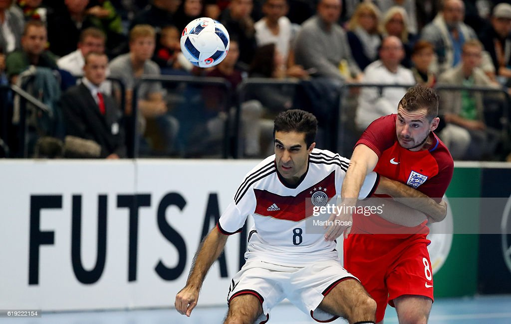 Saboor Khalili(L) of Germany and Luke Ballinger of England battle for the ball during the Futsal International Friendly match between Germany and England at Inselparkhalle on October 30, 2016 in Hamburg, Germany.