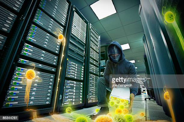 saboteur releasing viruses in server room - computer virus stock pictures, royalty-free photos & images