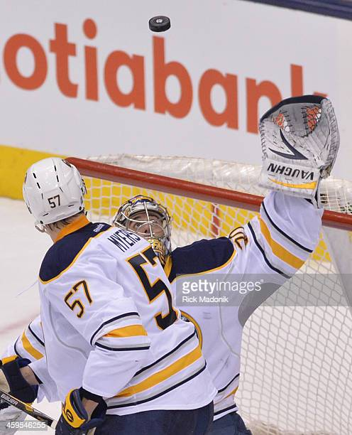 TORONTO DECEMBER 27 Sabre goalie Ryan Miller reaches for a puck that sails over the net Toronto Maple Leafs vs Buffalo Sabres during 2nd period NHL...
