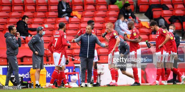 Sabri Lamouchi the manager of Nottingham Forest talking to his team in the drinks break during the Sky Bet Championship match between Nottingham...