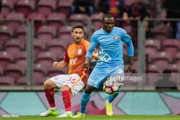 Sabri Sarioglu of Galatasaray Aminu Umar of Osmanlispor Futbol Kulubuduring the Turkish Spor Toto Super Lig football match between Galatasaray SK and...