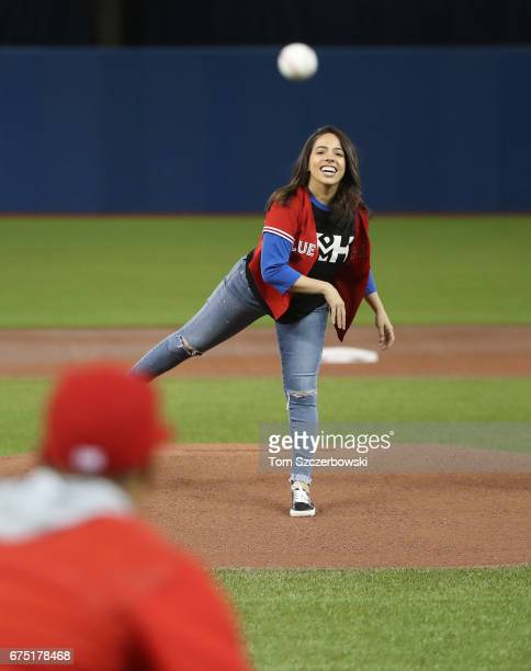 Sabria Abdat the sister of Marcus Stroman of the Toronto Blue Jays throws out the first pitch to her brotherbefore the start of MLB game action...