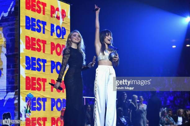 Sabrina Carpenter and Daya present the Best Pop award on stage during the MTV EMAs 2017 held at The SSE Arena Wembley on November 12 2017 in London...