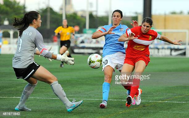Sabrina D'Angelo of the Western New York Flash Carli Lloyd of the Houston Dash and Brittany Taylor of the Western New York Flash battle for a loose...