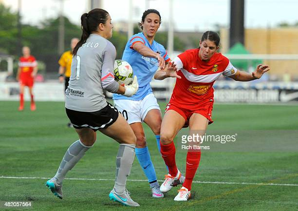 Sabrina D'Angelo of the Western New York Flash takes control of a loose ball in front of Carli Lloyd of the Houston Dash and Brittany Taylor of the...