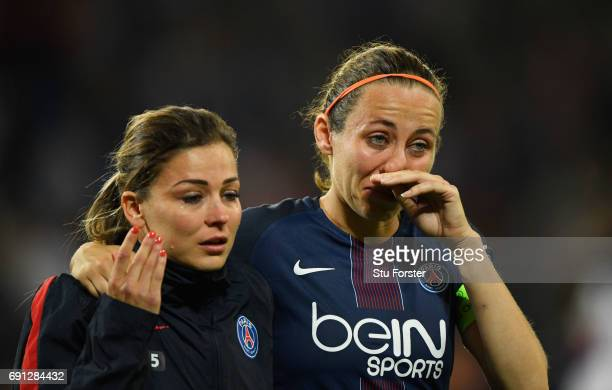 Sabrina Delannoy of Paris SaintGermain Feminines is consoled after penalty shoot out defeat during the UEFA Women's Champions League Final between...