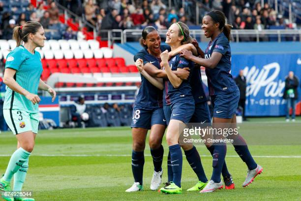 Sabrina Delannoy of Paris SaintGermain is celebrating her goal from a penalty shot with her teammates MarieLaure Delie and Grace Geyoro of Paris...