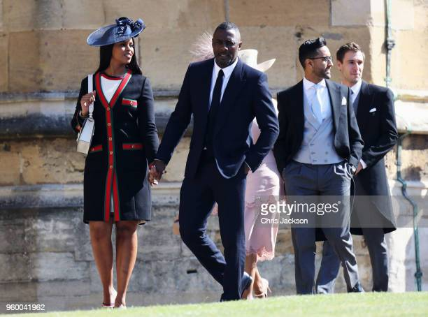 Sabrina Dhowre and Idris Elba arrive at the wedding of Prince Harry to Ms Meghan Markle at St George's Chapel Windsor Castle on May 19 2018 in...