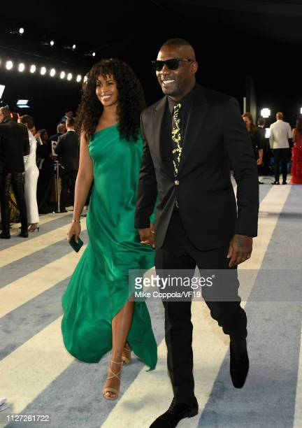Sabrina Dhowre and Idris Elba attend the 2019 Vanity Fair Oscar Party hosted by Radhika Jones at Wallis Annenberg Center for the Performing Arts on...