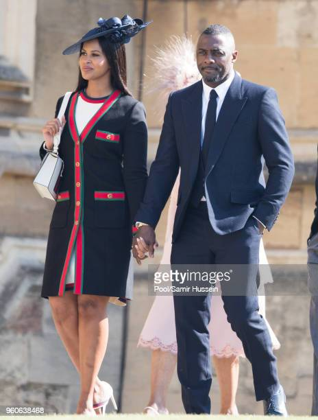Sabrina Dhowre and Idris Elba attend the wedding of Prince Harry to Ms Meghan Markle at St George's Chapel Windsor Castle on May 19 2018 in Windsor...
