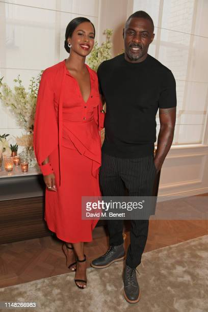 Sabrina Dhowre Elba and Idris Elba attend the Cartier and British Vogue Darlings Dinner at the Residence at Cartier New Bond Street on June 5 2019 in...