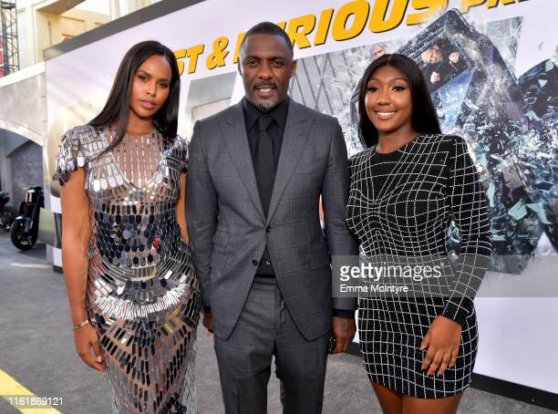 "Sabrina Dhowre Elba, Idris Elba, and Isan Elba arrive at the premiere of Universal Pictures' ""Fast & Furious Presents: Hobbs & Shaw"" at Dolby Theatre..."
